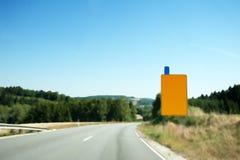 A yellow sign board Stock Photos