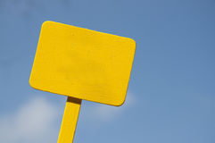 Yellow Sign on Bright Blue Cloudy Sky Royalty Free Stock Photos