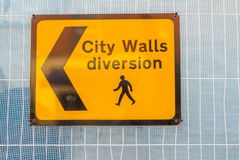 Yellow sign City Walls Diversion, Chester. Sign for The City Walls Diversion, Chester, United Kingdom royalty free stock image