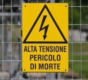 Yellow sign for danger high voltage attention 1 Stock Photos