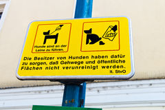 Yellow sign, dogs in the city Stock Photo