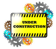 Yellow sign with gears and text Under Construction Stock Photo