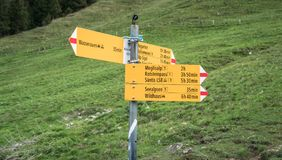 Yellow sign post with mountains in the Swiss Alps. Seealpsee, Switzerland - May 2017: Yellow sign post with mountains in the Swiss Alps Royalty Free Stock Images