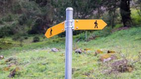 Yellow sign post with mountains in the Swiss Alps. Seealpsee, Switzerland - May 2017: Yellow sign post with mountains in the Swiss Alps Royalty Free Stock Photography