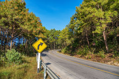 Yellow sign on the road with clear sky at the way to pai Stock Photography