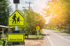Yellow sign school zone symbol in the countryside Royalty Free Stock Photography