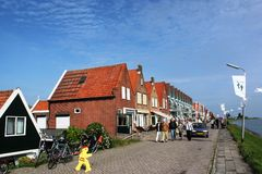 Yellow sign of slow traffic, Volendam Stock Photo