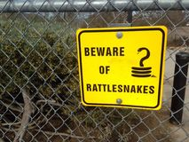 Yellow sign state beware of rattlesnakes Stock Image