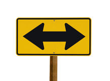 Yellow sign with two arrows pointing in opposite Stock Image