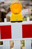 Yellow signal lamp on construction site Royalty Free Stock Photos