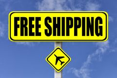 Yellow signboard with the words Free Shipping written stock photos