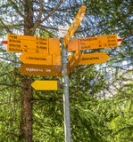 Yellow Signpost with directions to various hiking trails in Matterhorn, Zermatt, Switzerland, Europe Royalty Free Stock Images