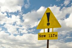 Yellow signpost with the text new life royalty free stock photos