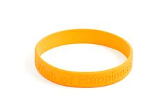 Yellow silicone wristband Stock Image