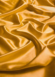 Yellow silk background Stock Images