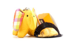Yellow silk elephant toy and croissant Royalty Free Stock Images