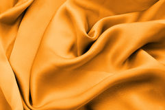 Yellow silk fabric background Stock Photos