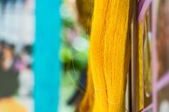 Yellow silk fiber. Close up color of raw thai silk threads Royalty Free Stock Photography
