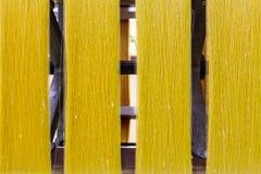 Yellow silk in machine Stock Images