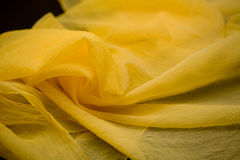 Yellow silk tender colored textile, elegance rippled material Stock Photos