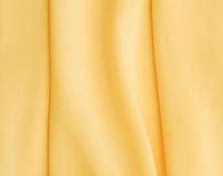 Yellow silk texture of satin abstract background Stock Image