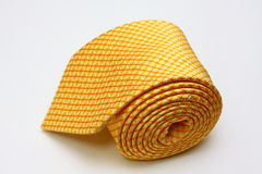 Yellow Silk Tie. Yellow business power silk tie on isolated white background royalty free stock image