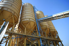Yellow silos industrial plant Royalty Free Stock Photos