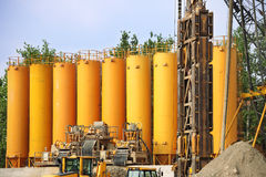 Yellow silos in industrial site Stock Image