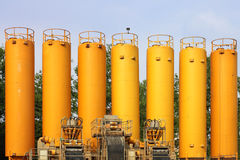 Yellow silos in industrial site Stock Photos