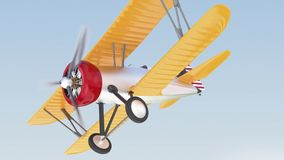 Yellow and silver biplane flying in the sky stock video