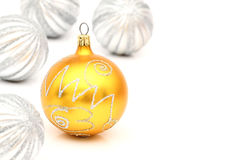 Yellow and silver christmas ball on white Stock Images