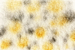 Yellow and silver spots, sprayed in the snow Stock Images