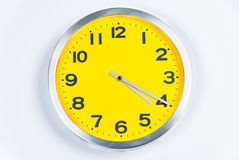 Yellow and Silver Wall Clock Stock Photos