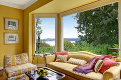 Yellow sitting area  with large window Stock Images
