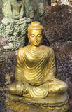 Yellow sitting Budha image Stock Images
