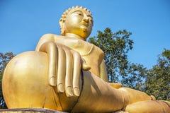 Yellow sitting Budha image with blue sky Stock Photos