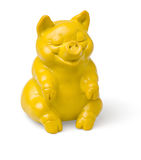 Yellow sitting piggy figure Stock Photography