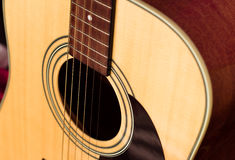 Yellow six-string acoustic guitar close-up. Yellow six-string acoustic guitar with black elements close-up. isolated Stock Photo