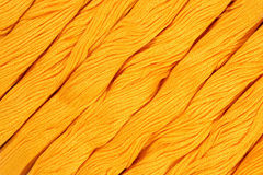 Yellow skeins of floss as background texture Stock Images