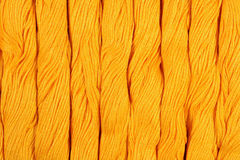Yellow skeins of floss as background texture Royalty Free Stock Photography