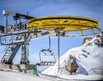 Yellow ski lift wheel Stock Photo