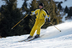 Yellow skier on ski slope Royalty Free Stock Images