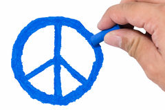 Yellow skin Asian man's right hand drawing blue color peace symbol Royalty Free Stock Image
