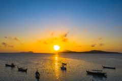 Yellow sky during sunrise above fishing boats in Rawai sea. Phuket Thailand stock images