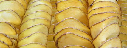 Yellow sliced fried potatoes royalty free stock image