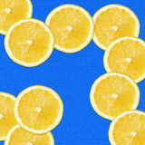 Yellow slices on blue Royalty Free Stock Photos
