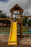 Yellow slide in a children park Royalty Free Stock Photo