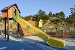 Yellow Slide in a Playground royalty free stock images