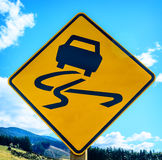 Yellow slippery road sign Stock Photography