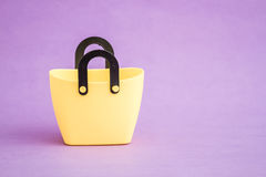 Yellow Small Decorative Plastic Bags with handle on Purple  Back Royalty Free Stock Images